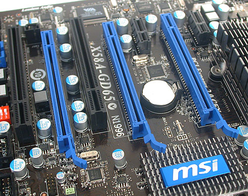 With three PCIe 2.0 x16 slots spaced out evenly, it's no surprise that this board can support 3-way SLI/CrossFireX. Looking at the right, while MSI has tried to put the heatsink out of the way of the PCIe x1 slot, it still seems a tad insufficient to us for anything but a short expansion card.