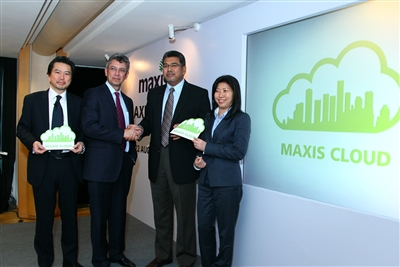 From L-R: Chong Pow Min, Maxis' Head of Fixed Business Services; Fitri Abdullah, Senior Vice President of Maxis Business Services; YBhg Datuk Badlisham Ghazali, Chief Executive Officer of the Multimedia Development Corporation (MDeC) and Ng Wan Peng, Chief Operating Officer of MDeC