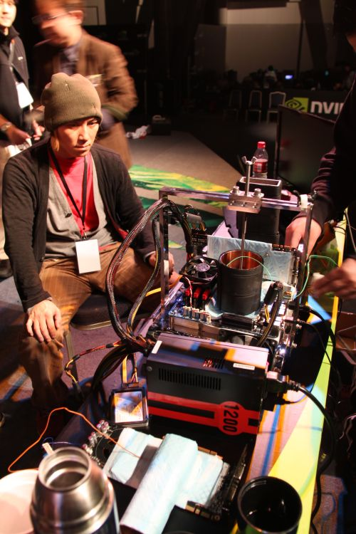 "One of the highlights of the festival was when Japanese overclocker, nicknamed ""Duck"" (wearing a beanie), came on stage to overclock the NVIDIA GeForce GTX4 80 GPU beyond its 700MHz default clock speed."