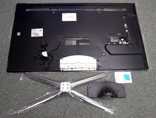 Here are some of the primary  parts you'll find out of the box. Some assembly is required in assembling the C7000, like attaching the stand and backplate to the TV for example.