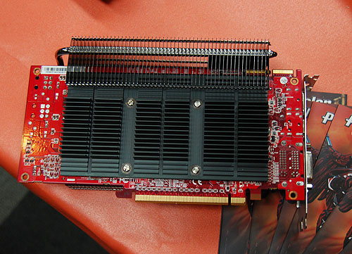 A solid slab of heatsink covers the back of the card.