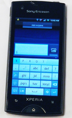 On entering a text input box, the phone starts off with an old-school alpha-numeric keypad in portrait mode...