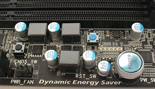 Around the larger power button, there's a black Clear CMOS switch and a small blue button to reset the system.