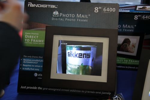 "US-based Pandigital showed us an 8"" Digital Photo Frame with a SIM card in the device. Basically, right off the box, users will have an email address from the frame that they can attach and send images to instantaneously. Thanks to the SIM and algorithm in the frame, images are automatically resized to fit the frame and your family can immediately view the images wherever you send them from. We thought this was genius and would love to see service providers in Asia bundle this nifty gadget with their long-term service mobile plans. Oh the Photo Mail Digital Photo Frame can store up to 6400 images."