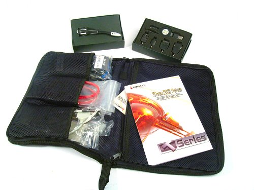 Stylish packaging sees motherboard peripherals in a neat toiletry bag plus the two free gifts of a USB travel charger and stereo earphone/mic set.