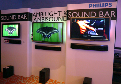 Philips' upcoming 9000 series (the one in the middle) is just a mockup of the actual display. If realized, the 3D-capable screen will tout some visual treats such as a three-sided Ambilights and full LED backlights. Although nothing is cast in stone at this moment, there is a chance you might have to purchase its 3D glasses (PTA02) separately.