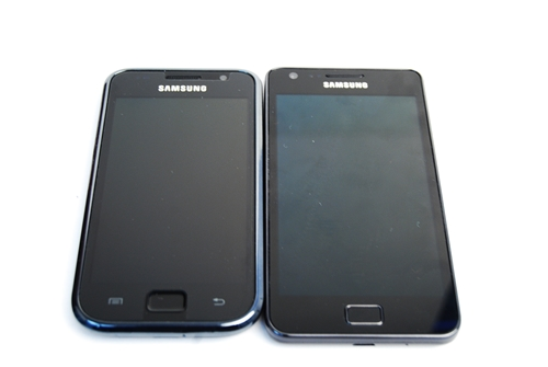Samsung Galaxy S (left) and Samsung Galaxy S II (right). Notice the absence of the chrome bezel on the latter. On the Galaxy S II, the Menu and Back touch buttons lit up once the screen was activated.
