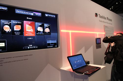 Toshiba has announced Toshiba Places, a music and download service that is capable of working across different Toshiba devices, seen here on its TV, notebook and the new Folio 100 (far right), an NVIDIA Tegra 2-based, Android-operated 10.1-inch WSVGA tablet device.