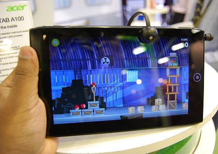 The upcoming Acer Iconia Tab A100 claims to be the first 7-inch (1024 x 600) Android 3.0 tablet Uses NVIDIA's Tegra 2, with two cameras, a 5MP rear facing and a 2MP front facing camera for video calls. 720p video playback is supported with HDMI output.