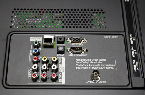 Situated behind the panel are a single component and two composite ports. That's also more than enough to handle legacy and analog equipment such as a Wii or a basic DVD player. Other offerings include an Ethernet port, digital audio out (optical), RF input, RGB In (VGA) and RS-232C ports.