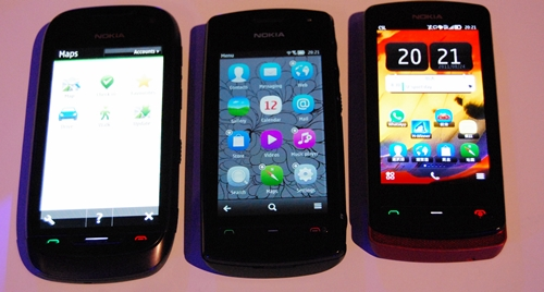 """Symbian Belle gets """"smarter"""" with a new adaptive menu bar at the bottom of the screen. Depending on what you are doing on the phone, the menu bar changes accordingly. Seen here are the three different menu bar options on the Nokia 701, 600 and 700 (left to right)."""