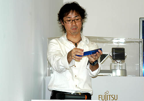 Kenichi Kimura himself demonstrating how easy it was to fold up the origami inspired concept laptop.