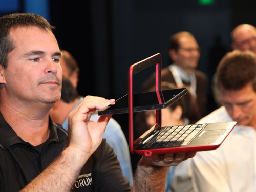 Intel booth staff demonstrating how the tablet could be converted into a netbook form factor.