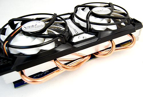 The custom cooler is massive and unlike Sparkle's implementation, the one here gets the full four copper heat pipes.