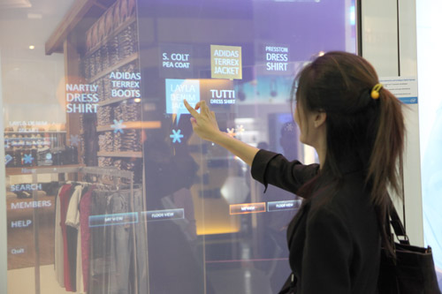 The touch screen interaction allows users to easily navigate through shopping deals with ease.
