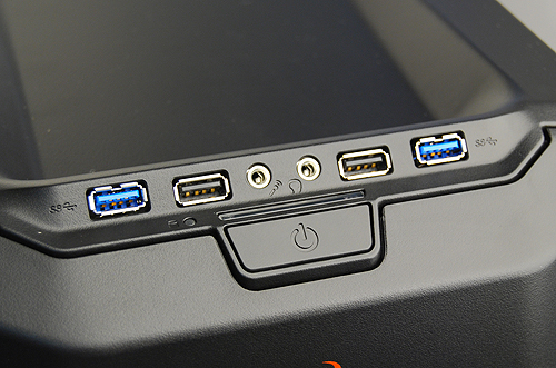 The Enforcer has four USB ports, two of which are USB 3.0 compatible. There are also jacks for headphones and microphones. The reset button, if you are wondering, is hidden behind the front cover.