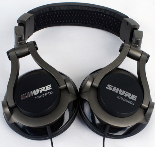 The Shure SRH550DJ Headphones with the ear cups rotated to their maximum 45-degree angle, lying flat against the table in our labs.