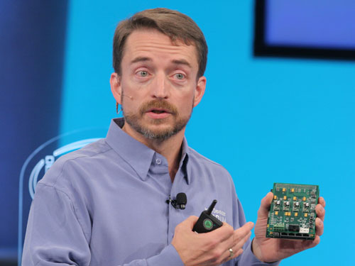 Intel senior vice president and general manager of the Digital Enterprise Group shows a running prototype of an L3 NIC, which is a prototype FPGA which Intel will make available to developers through their partners Altera and Xilinx.