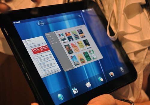 The HP TouchPad and its webOS UI. We weren't allowed any hands on time unfortunately, and while the device seems smooth enough, we did see some problems at another demo like touch inputs not registering on the OS at all. We hope the perfected devices will launch on time though.