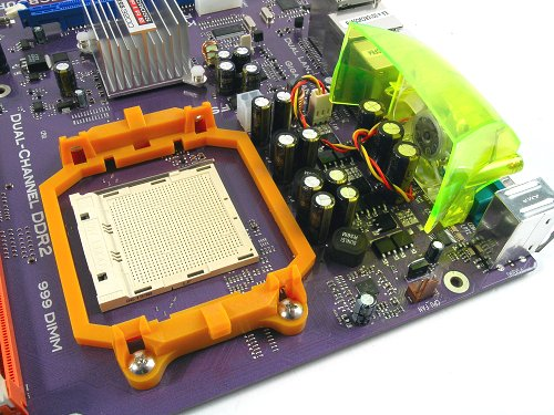 Brightly colored AM2 socket. Like all of ECS' boards, the familiar rear fan exhaust helps cool the capacitors.