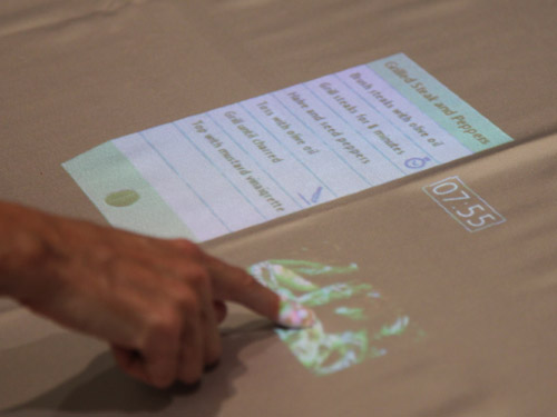 Step-by-step instructions are displayed via an overhead projector.