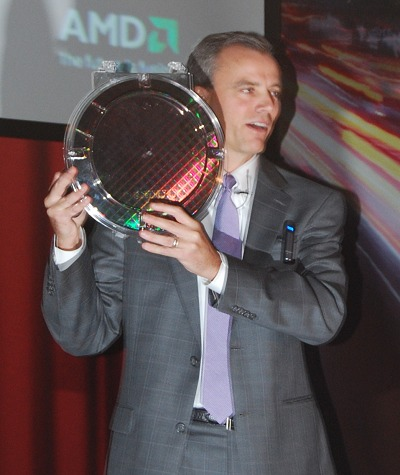 The first Llano APU 32nm SOI wafer held up by Chris Cloran, Corporate VP and GM of AMD's Client Division.