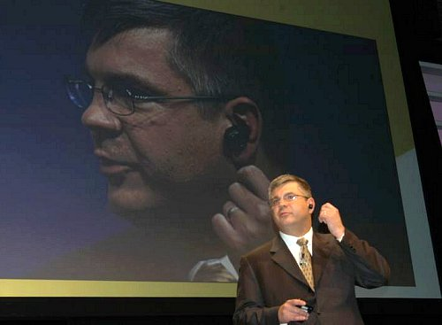 Ron Garriques, president of Motorola's mobile devices business, is seen here wearing the H5 MINIBLUE Bluetooth headset. It's the smallest in existence, and picks up voice through the ear canal.