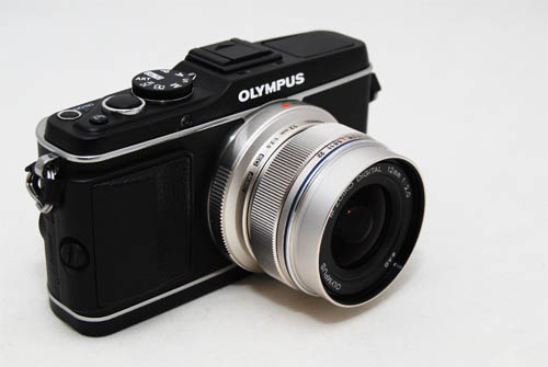 The 12mm f/2 doesn't add a lot of size and weight when attached to an MFT camera, like the Olympus E-P3 pictured here.