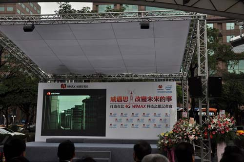 The stage is set up in an open area to showcase WiMax's outdoor capabilities.