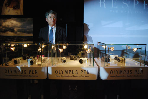 Hirofumi Imano, General Manager, Design Center, Olympus, unveils the three PEN cameras.