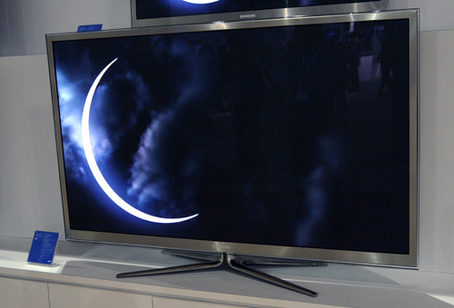 """Dark skies and a crescent moon highlight the black-level prowess of the Series 8 (aka D8000) PDP. This 64-incher comes equipped with a Real Black Filter, web browser and built-in WiFi. As mentioned, it also touts Samsung's """"Plasma +1"""" design with one inch more of screen estate."""