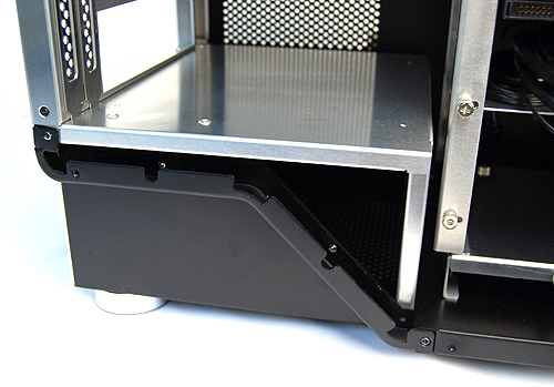 "The PSU is located at the bottom of the casing and for reasons beyond us, Cubitek has decided to ""shield"" the bay area, which makes it a hassle to install PSUs, because they have to be inserted from the rear. And with the drive cage just in front, it's hard to route the various cables through."
