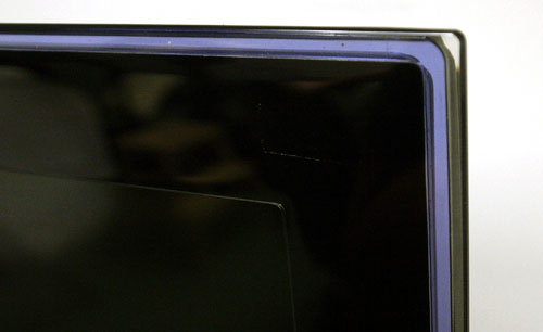 The purple strip is more obvious in photos than it really is. The colored accent is subtle but it distinguishes the LW6500 from more conventional looking HDTV displays.