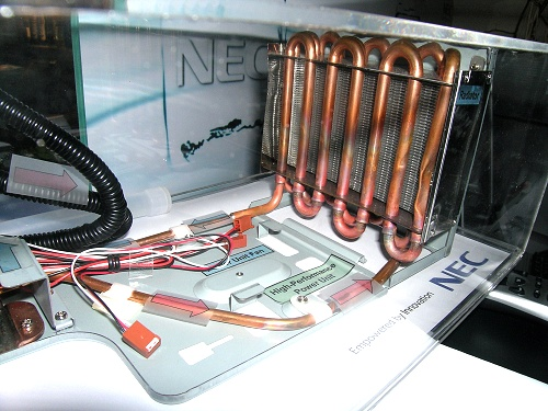 Not your standard water-cooling radiator either, looks more like a mini car radiator.