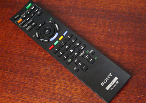 "Sony's remote is one of the less cluttered ones we've seen. It might not offer a whole lot of buttons at your disposal, but it has just enough controls for fuss-free navigation. A dedicated ""Home"" button is highlighted in blue below its directional pad, whilst controls for other AV peripherals (linked by BRAVIA Sync) are positioned on top."