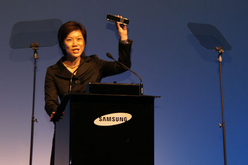 Irene Ng, Strategic Marketing Director of Samsung Singapore, waves the touch-screen remote control for the flagship LED 9000 HD 3D TV.