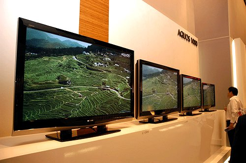"""Among the many TVs shown at Sharp's exhibit, the company's main thunder came from its 42"""" AQUOS LCD TV, which plugs the gap between its 65"""", 52"""", 46"""" and 37"""" model, thus completing its XD1E Full HD line-up. With 1080p display support for its full complement of AQUOS TVs in the bag, the line-up boasts contrast ratios of 1200:1 (native) and 6000:1 (dynamic). Best of all, the AQUOS TVs have a low pixel response time of just 6 milliseconds."""
