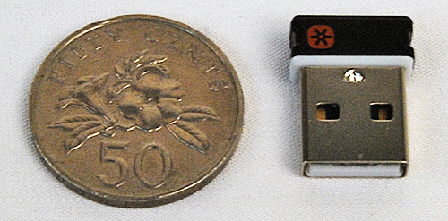 The unifying receiver can sync with multiple Logitech wireless devices, saving precious USB slots. Here it is with a Singapore 50 cent coin for scale.