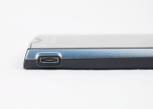 A bare-bodied USB port sits on the top left side of the phone.