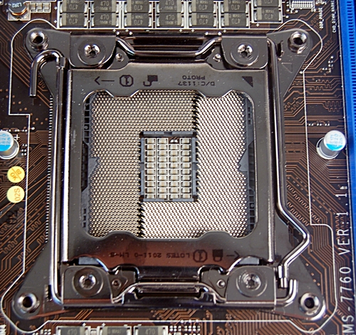 The LGA2011 CPU socket is larger than the usual CPU sockets found on consumer computing platform. This is due to the large pin count which number a mind-blogging 2,011. This is mostly the result of a quad-memory controller implementation and more power/control lines to manage this complex CPU. After all, this is a workstation-class processor. Extra caution must be exercised in mounting the Sandy Bridge-E processor as the sheer number of pins translate to higher risks of them being bent due to carelessness.