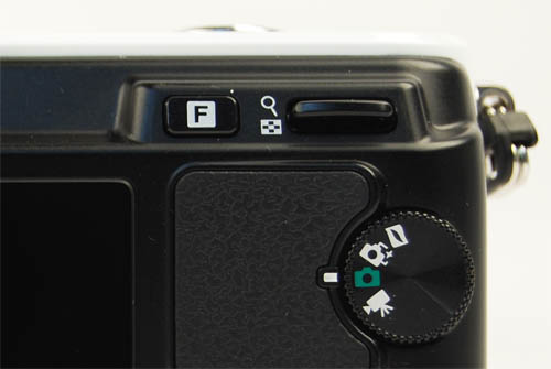 This toggle works to control aperture or shutter speed in the respective priority mode. It works, but is slower than the conventional control dial found on DSLR cameras.