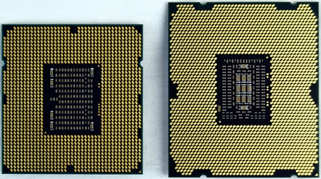 Shown here on their backs is their contact pads interfacing with the motherboard socket. On the left, the LGA1366 faces off with the LGA2011 on the right.