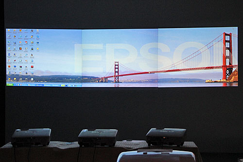 The EB-1880 has a Multi-screen Display feature that allows one computer to use up to four projectors to show four different images or a single panoramic image across four screens.
