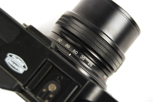 Unlike some other cropped sensor lenses, the focal length markings on the X10 are in 35mm equivalent. Very useful.