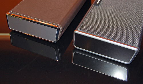 Besides the leather casing, the premium luxury model of the Bose SoundLink (left) also has a chrome finish that's not present on the regular model (right).