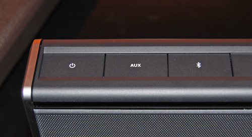 The top left corner of the Bose SoundLink has the Power, Aux and Bluetooth buttons.