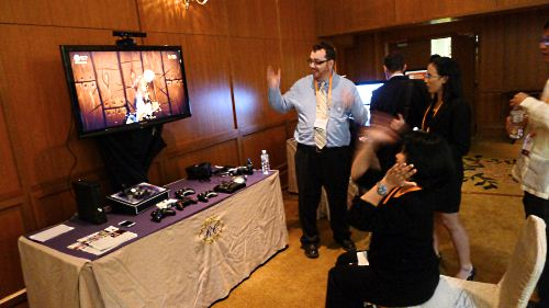 An enthusiastic participant tests the video game Fruit Ninja for Kinect on the Xbox 360