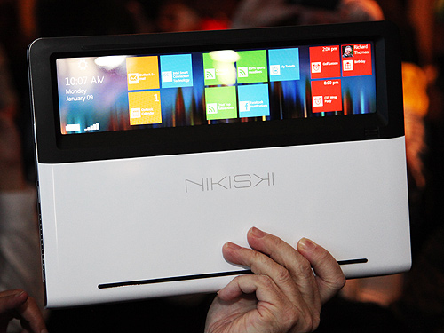 A working model of Intel's concept Ultrabook codenamed Nikiski. When the Ultrabook is closed, the clear touch panel allows you see part of the screen, allowing the user to quickly access information without opening the laptop.