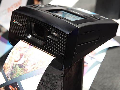 The Polaroid Z340 even sends prints out from the front, just like how it's done in the analog days.