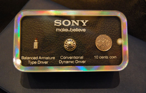 A direct comparison of size between Dynamic and Balanced Armature drivers with a 10-cent coin put in for reference.